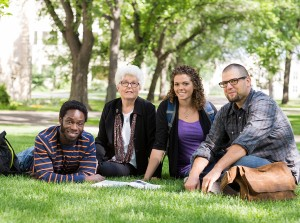Graduate student seminar with professor on campus lawn