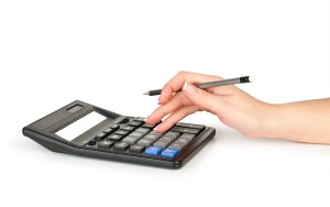 student with calculator and pen