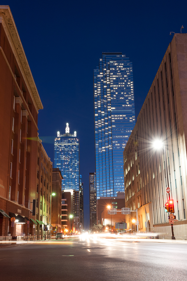 Business tower at nigh from well lit street in Dallas Texas