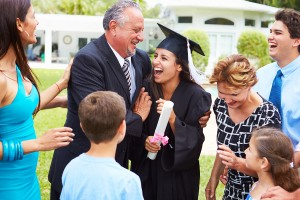 Hispanic family celebrating daughter's college graduation